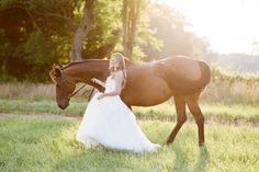 Beautiful bridal portrait of the bride and her horse. Photo: Charlotte Tittle Photography.