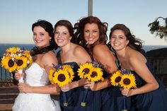 Blue and yellow wedding. Sunflowers are the best.