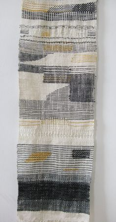 Greys and yellows. Subdued. Woven.