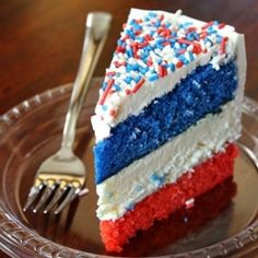 Red, White and Blue Cheesecake Cake:  2 layers of vanilla cake sandwiched around a layer of cheesecake.