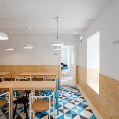 Image 27 of 37 from gallery of Hostel CONII / Estudio ODS. Photograph by João Morgado Hotel Interiors, Office Interiors, Work Cafe, Hostels, Clerestory Windows, Small Tiles, Shared Bathroom, Upstairs Bathrooms, Suites