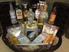 Manly gift basket. Mini liquor bottles on sticks, snack, nfl freezer mug and nfl tickets. My fiancé loved it!