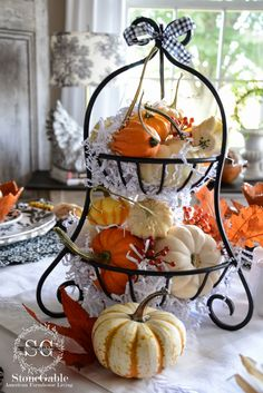 Make use of trays you already have by digging through your cabinets and storage spaces. You'll never know what you'll find until you try! Once you have located your kitchenware, showcase an assortment of pumpkins to keep your house festive.