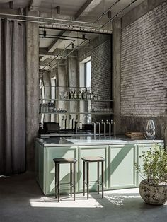 Rene Redzepi's 108 Restaurant by SPACE Copenhagen   Yellowtrace. raw exposed bricks contrast against the mint green bar front
