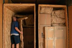 Movers pack a military members property into boxes and load it into crates to be transferred to a temporary storage facility in O'Fallon, Illinois, July 1, 2019. (U.S. Air Force photo/Stephenie Wade)