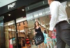 Long Island's Westfield South Shore Mall in Bay Shore is the first location in the New York area for the global fashion retailer F&F. The store sells clothing for women, men and children. Here, sales associate Jamie Hauser stands outside the store, directing customers inside.