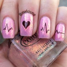 Heart rate/pulse nails with a shiny glitter topped for Valentine's Day by @melcisme.