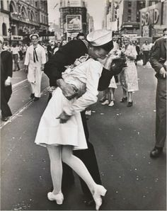 American Sailor Clutching a White-Uniformed Nurse in a Passionate Kiss in Times Square.