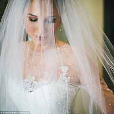 Dreamy:There is also an image of her dress - a white strapless design with a sheer polka dot and fancy French lace top