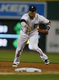 Tigers first baseman Victor Martinez races to step