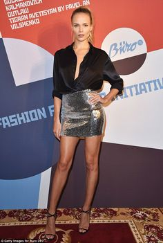 Shimmer: Natasha, meanwhile looked equally striking with a sequinned mini skirt which showed off her endless legs