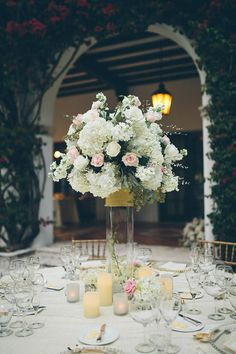 Featured Photographer: Daniel Lateulade; wedding reception centerpiece