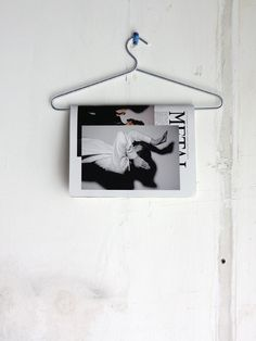 Maybe a pants hanger could be used to hold magazines in the bathroom?