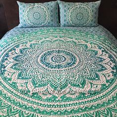 Our Oceana Ombre mandala tapestry is now available as a quilt! This quilt is two cotton sheets sewn together with netting inside. It is 100% cotton and reversible. Also comes with matching quilted pil