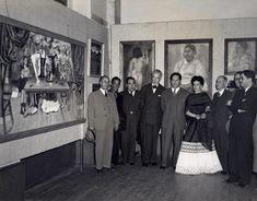 "Frida at art gallery showing her work ""la mesa herida"""