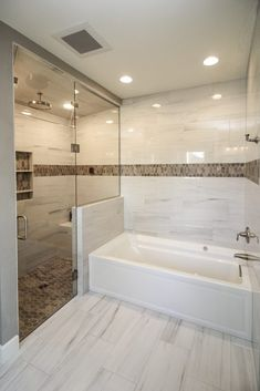Marble Tiled Bathroom Flooring and Walls With Brown Tiled Accents Brown Tiles, Tile Layout, Marble Tile Bathroom Shower, Marble Tile Bathroom, Bathroom Flooring, Brown Tile Bathroom, Bathrooms Remodel, White Master Bathroom, Tile Around Bathtub