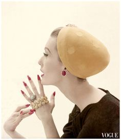 Mary Jane Russell wearing a hat of lemon velour by Adolfo of Emme, holding gold and diamond jewels from David Webb Photo Richard Rutledge Vogue Sept 1955.