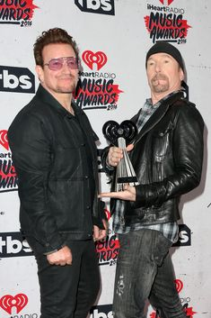 Bono Photos Photos - Singer Bono (L) and musician The Edge of U2, winners of the Innovator Award, pose in the press room during the iHeartRadio Music Awards at The Forum on April 3, 2016 in Inglewood, California. - iHeartRadio Music Awards - Press Room