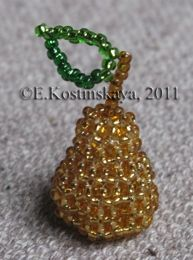 Beaded Pear Pattern. Look at this pear. It is so ripe, that it almost shines! It can be used as a pendant or an earring. The pattern includes a photo, 5 graphs and very detailed instruction of weaving this fruit.