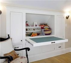 Sloped ceiling storage solution-maybe for a desk area when girls want to project or do work upstairs?