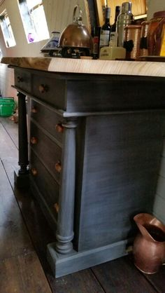 Gas hob fitted into waney edge wood worktop. Chest of drawers from charity shop painted in Annie Sloan Paris grey and graphite. Narrowboat Recalcitrant August 2015