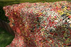 ArtZuid 2013 presented this work by El Anatsui from Ghana 'Drying towels and pants' made from metal waste.