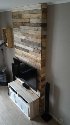 #Drawers, #Dvd, #EntertainmentUnit, #Fireplace, #HomeTheater, #LivingRoom, #PalletFurniture, #PalletWall, #RecycledPalletShelves, #RecyclingWoodPallets, #RepurposedPallet, #Storage, #Upcycled, #Wood Entertainment Center Wall from pallets: The idea is to hang the TV and hide the wires behind the wall; I did not wantto see the cables. I also need a location for CD / DVD drives. I created the wall that welcomes the home theater components, game