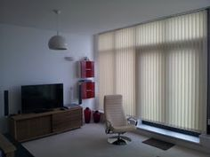 Lounge designer vertical blinds, here are vertical blinds installed into a lounge. Very large patio and glazed area. Blinds supplied and installed by Blindology Blinds of Plymouth. Vertical Window Blinds, Blinds For Windows, Plymouth, Lounge, Patio, Design, Shades For Windows, Airport Lounge, Terrace
