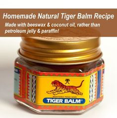 Homemade tiger balm with essential oils in beeswax and coconut oil