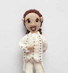14 inch Crochet Hamilton 1800s Style Amigurumi Art Doll This adorable crochet doll has a 19th century style about him. I especially love the brass buttons on his jacket. He has rosy cheeks a little bit of a smirk, and his arms and legs are pose-able. He stands between 13-14 tall. Each doll will vary slightly.   The doll is mostly 100% acrylic yarn and stuffed with polyfil (polyester fiber fill/pillow stuffing). He is created in a smoke free, dog friendly environment.
