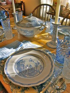 "table set with blue transferware ... for their weekly Sunday night ""breakfast for dinner"". We do that too, only it's usually on Thursday! I like the idea of switching to Sunday for a homey meal."