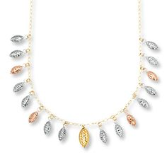 Capture all the gold and all the style with this intriguing necklace showcasing multiple drops of beads in alternating gold colors.