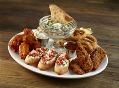 JUMBO COMBO A collection of our most popular appetizers: Signature Wings, Onion Rings, Tupelo Chicken Tenders, Spinach Artichoke Dip with Parmesan flatbread and bruschetta. Served with honey mustard, hickory barbecue and blue cheese dressing.