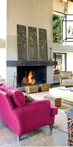 The hot pink sofa adds drama and warmth to this all neutral room.