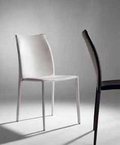 Leather Chair available in white, black or chocolate colors.