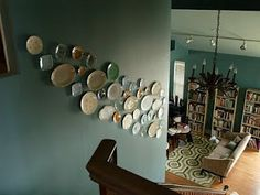 Plates on the wall, ascending or descending, depending on where you are going.  Either way, the flow is fun!