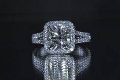 Beautiful 18 karat white gold Halo setting with a 3.02 Cushion Brilliant cut Diamond......