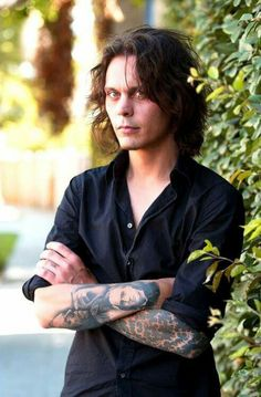 Ville Valo with his author tattoos on display.