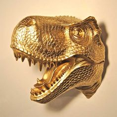 How funny is this? This adorable hand-made gold T-Rex wall mount is a definite conversation piece. Click through to see this and similar items by Designers Near and Deer.