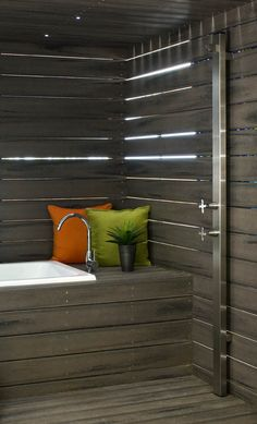 An outdoor spa retreat featuring the perfectly placed Suncoast Wall Shower. Do you have any outdoor bathroom ideas?