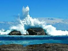 Image result for wave breaking on rock
