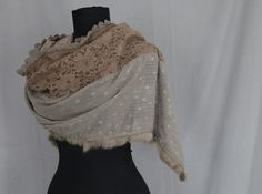 Embroidered acrylic lace scarf with faux fur edging. Lightweight, soft and very warm on the skin.