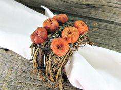 Pumpkin and Grapevine Twig Napkin Rings for Fall, Autumn and Thanksgiving (Set of 4, 6, 8, 10, 12). Handcrafted natural grapevine napkin rings for autumn celebrations. These rustic napkin rings are made of natural grapevine twigs and real putka pods that look like adorable miniature pumpkins. They are the perfect touch for your fall dinners or rustic Thanksgiving table. You can choose your set size during checkout. ***Made to order so they will have their own unique variations from those...