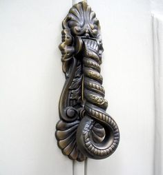 Door Knocker - If you'd rather not choose any suggestive designs, maybe something a little more abstract is for you.