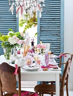 I pinned this under dining rooms, but really I love the tablescape and most especially those SWEET ribbons tied to each chair.  The table is really set off nicely by the weathered blue-painted shutters dont you think?