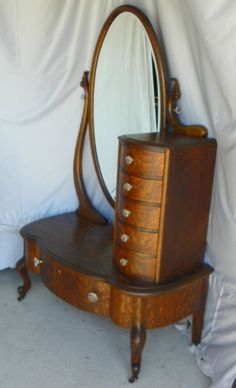 """A very rare quarter sawn oak cheval lingerie in very good original finish! The dresser is all quarter sawn oak with bird eye maple drawer bottoms and nice detail carvings. All of the hardware is all original, the oval beveled mirror is in good condition. Measures 69""""Height, 42"""" width and 21"""" Depth. Often referred to [...]"""
