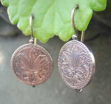 These Victorian Floral Disc Chased Earrings in 14k Rose Gold are Ideal for Summer. They are both Beautiful and Whimsical. The chase work is what sets these Victorian Floral Earrings apart. As the Rose Gold Discs catch the light - the chase work Comes to Life. Circa 1700 Jewelry Line.