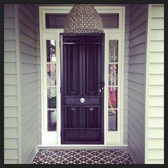 Black door with white surrounds. Paint screen black too? Front Porch, Front Doors, Encaustic Tile, Front Entrances, Black Doors, Grand Entrance, How Beautiful, Tiles, Exterior