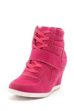 Bucco Karey Wedge Sneaker I kid you not, i saw a lady wearing these at the gym, trying to work out in them!! REALLY???  These are the stupidest looking ugly wedge shoes i've ever seen!!!  I don't get how these wedge shoes are in style. Ridiculous!