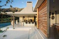 A dream holiday house for sale in South Africa: One outdoor area includes a braai (barbecue) area with a marble bar. love the simple roof lines Indoor Outdoor, Outdoor Living, Outdoor Bars, Outdoor Pool, Farmhouse Architecture, Classic Architecture, Barbecue Area, Architectural Digest, Architectural Features